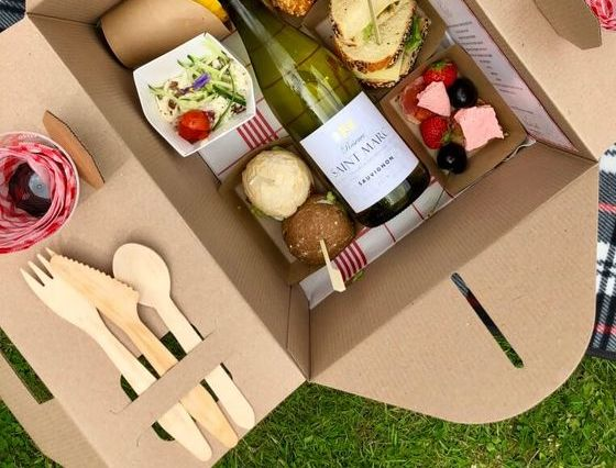 A picnic basket that has a die cut opening for utensils.
