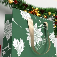 close up a 210g white cardboard bag with a matte lamination and gold ribbon handle