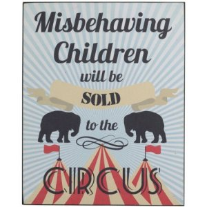 """A metal hanging sign that reads """"Misbehaving Children will be sold to the circus."""""""