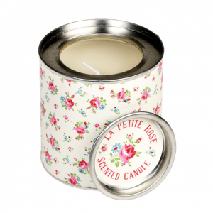 A floral rose pattern printed onto a circular candle