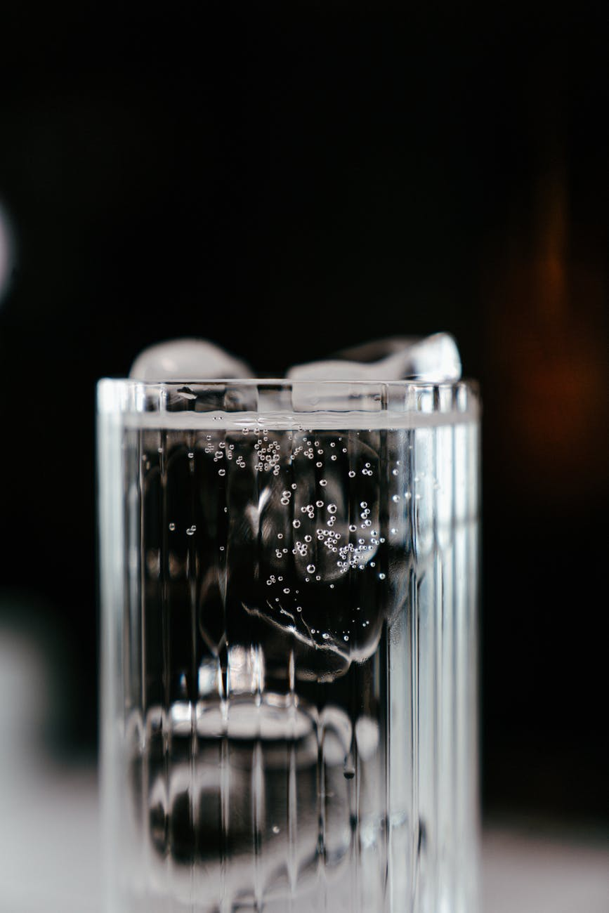 clear glass container with white round beads