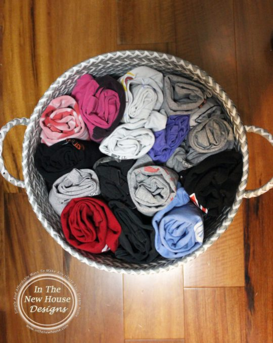 Roll Tee Shirts and Keep them in large baskets