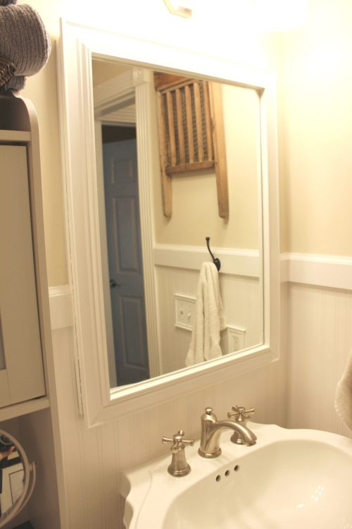 use leftover paint and trim to frame a builder grade mirror