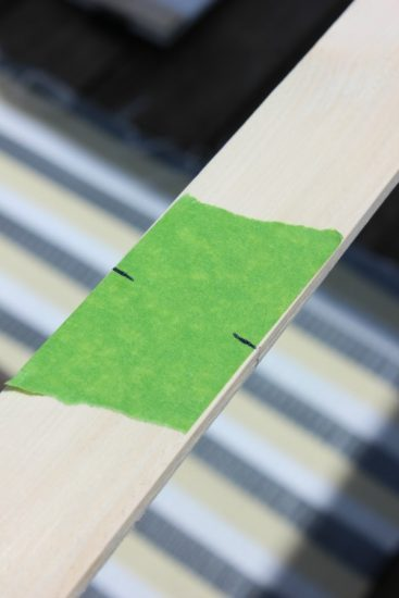 Use tape to minimize wood splinters when cutting