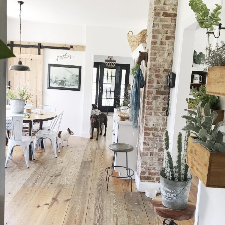 rustic farmhouse living and dining room with barn door