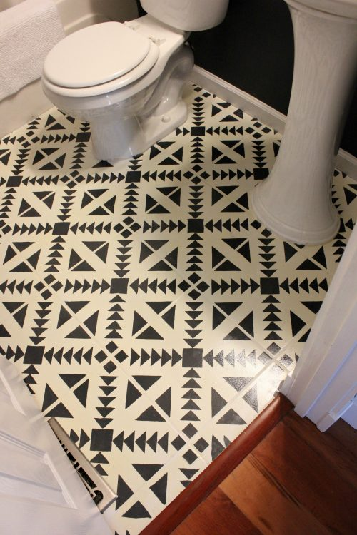 patterned painted floor tiles in bathroom with stencil