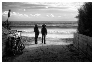 Friends glancing at the sea