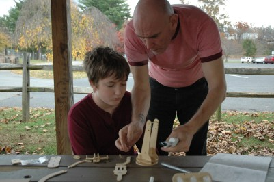 Jack and Daddy working on a robot
