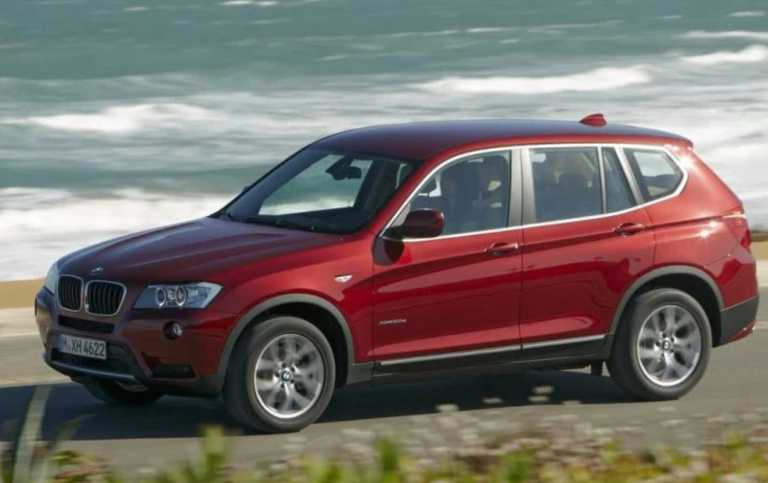 BMW X3 SUV side view driver's side