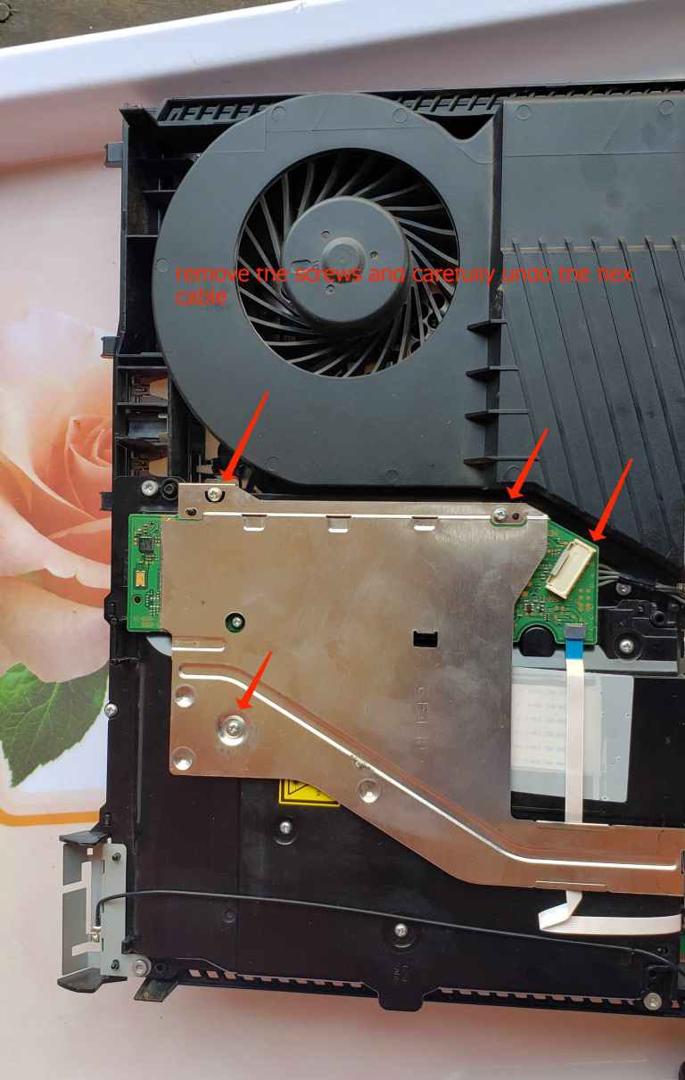 how to remove ps4 dvd drive metal plate cover