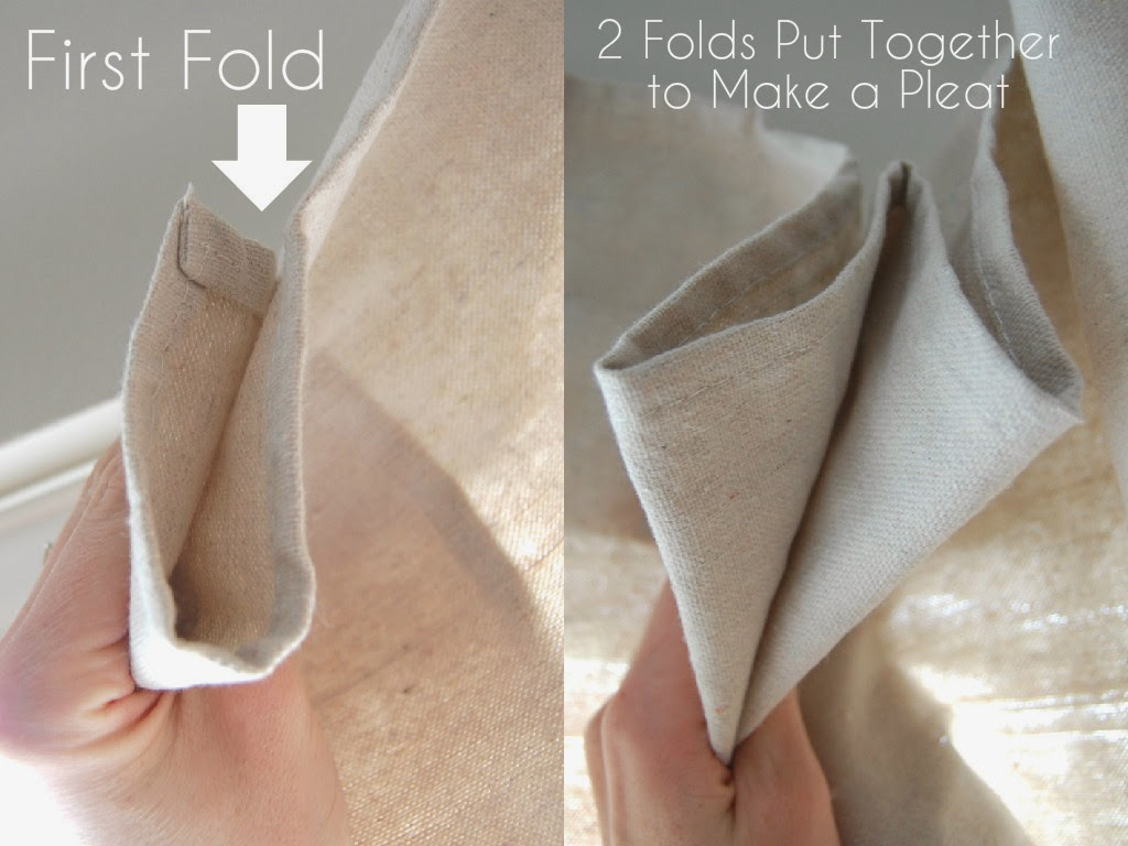 We used simple curtain clips to attach the drop cloths -  Then I Secured The 2 Folds With A Curtain Clip