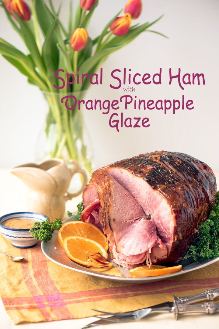 Spiral sliced Ham with Orange Pineapple Glaze, Recipe for how to cook a spiral sliced ham. A two step process of warming up the ham, first submerged in hot water, then roasted inside an oven bag. The ham is tender and moist and glazed with a orange pineapple glaze.