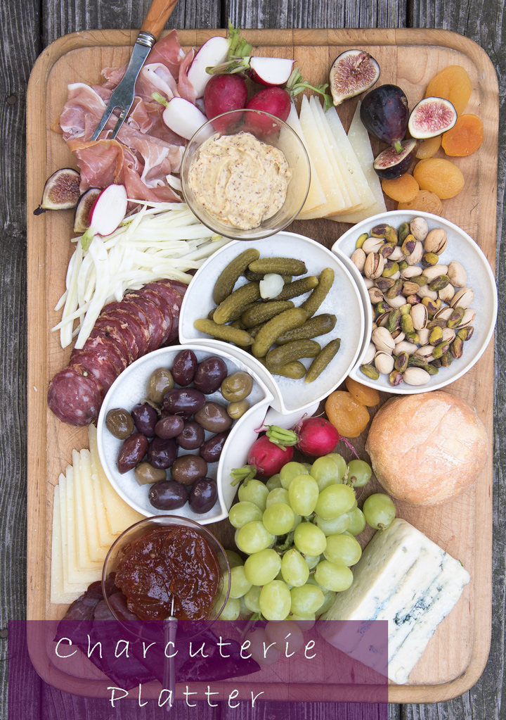 Building a Charcuterie Platter. A how to guide for making a delicious charcuterie platter. This charcuterie platter is filled with cured meats, cheese, pickles, fruit, vegetables, hot pepper jelly, mustard, and nuts.