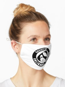 Woman wearing a face mask with Society of Unlikable Heroines logo