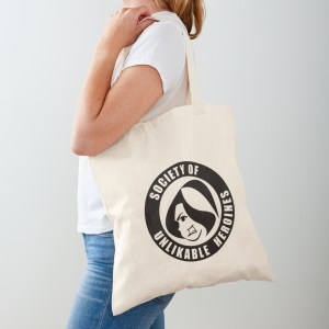Woman carrying a canvas tote bag emblazoned with the Society of Unlikable Heroines logo