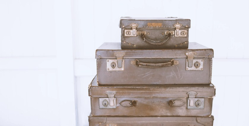 pile of vintage suitcases