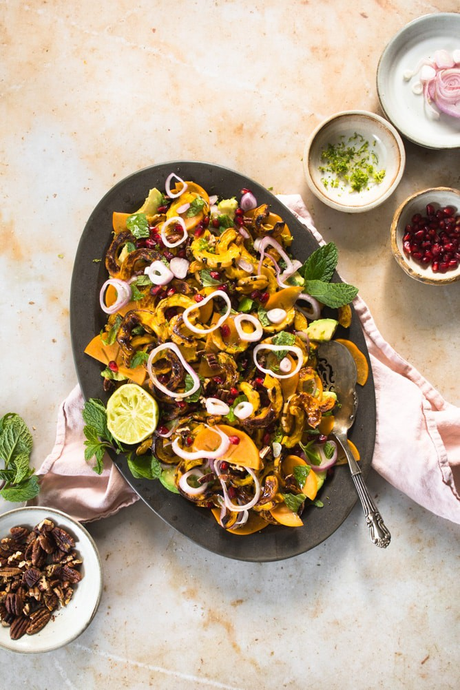 This delicata squash salad with persimmons is sweet, tart, creamy, crunchy and zesty. The perfect mix for a holiday salad to serve for any occasion.