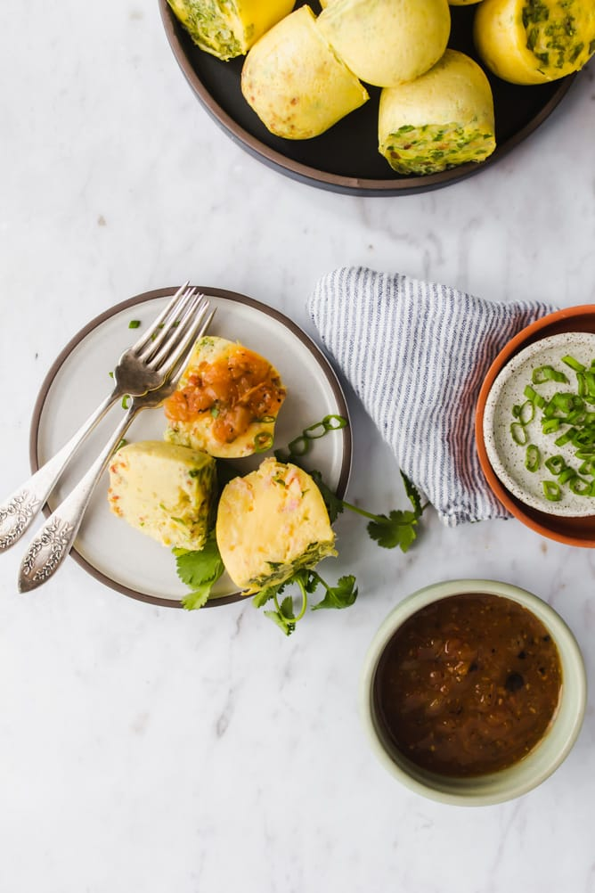 Instant pot egg bites on small plate served with salsa