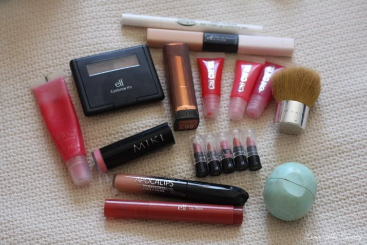 September Empties, including ELF eyebroe kit, EOS lip balm and Lancome Juicy Tube