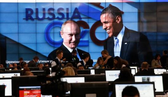 Hình ảnh Putin và Obama trên màn hình ở trung tâm báo chí của Hội nghị thượng đỉnh G-20 ở Strelna gần St. Petersburg, ngày 5/9/2013. (Grigory Dukor / Courtesy Reuters)