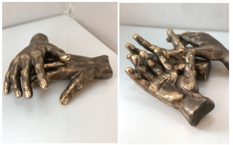 Et ægtepars hænder modelleret