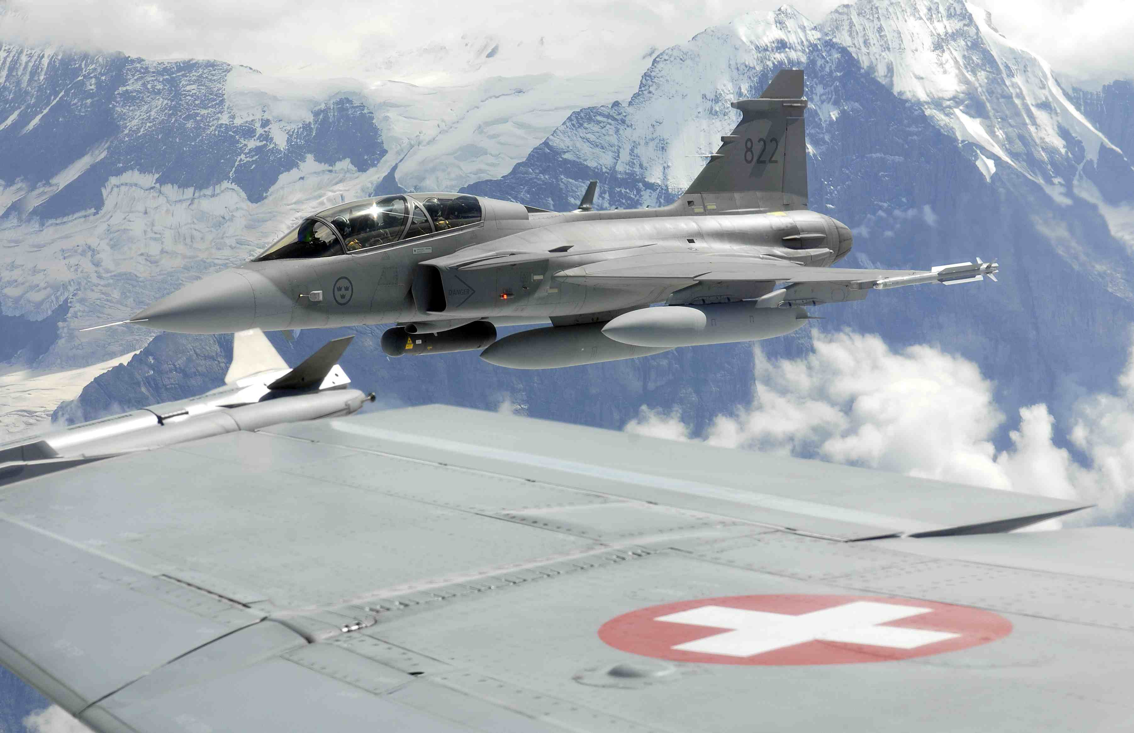 Gripen D flying over the Swiss mountains  Photo courtesy of Swiss Air Force