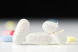 http://www.dreamstime.com/stock-photography-health-care-reform-debate-laws-obamacare-stack-pills-stamped-pills-pill-broken-half-representing-image36324292