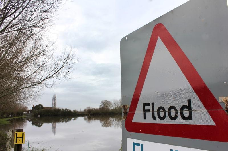 © Joseph Golby   Dreamstime.com - Flood Sign Warning by Flood
