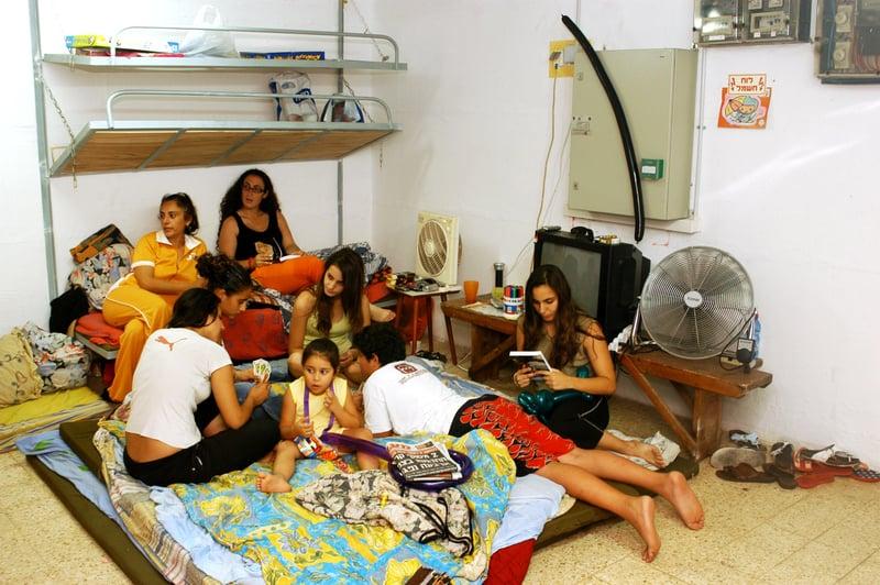 Family in a bomb shelter - © Rafael Ben-ari   Dreamstime.com