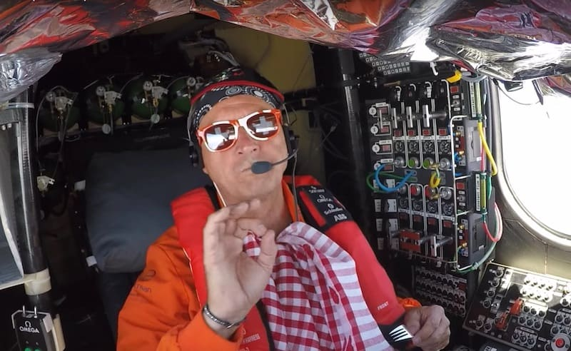 Following Swiss tradition, Andre eats raclette in the cockpit