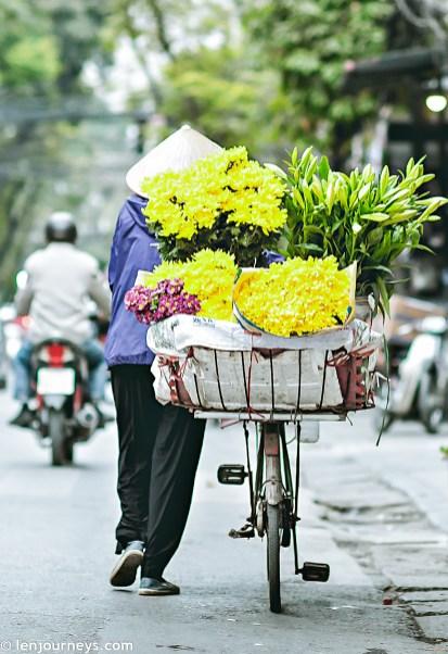 A flower street vendor in Hanoi's Old Quarter