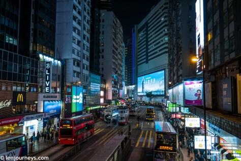 Bustling Hong Kong street at night