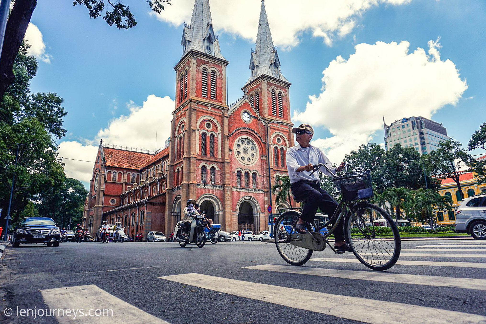 Man riding bicycle passing by Notre Dame Cathedral