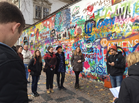 Anglo American University students reading poetry at the Lennon Wall for Den Poezie