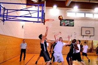 AAU contests for the ball in Masaryk University's territory.