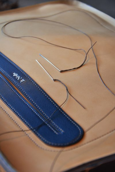 French workshop - Handmade leather stitching is one of a craftsman technique.