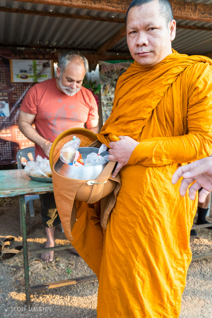 monk with food / wat pha luang ta bua, thailand