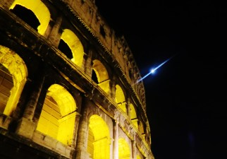 The moon and the Colosseum together side by side...