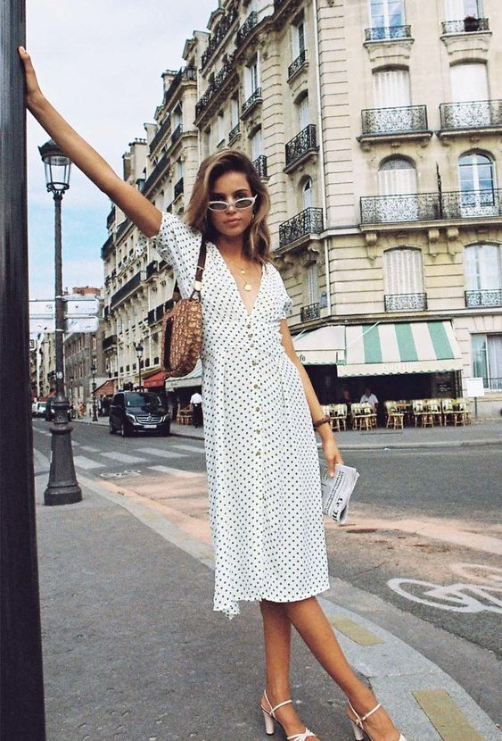 french girl wearing a summer button front dress