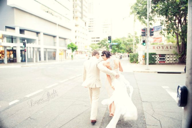 wedding couple walking through city