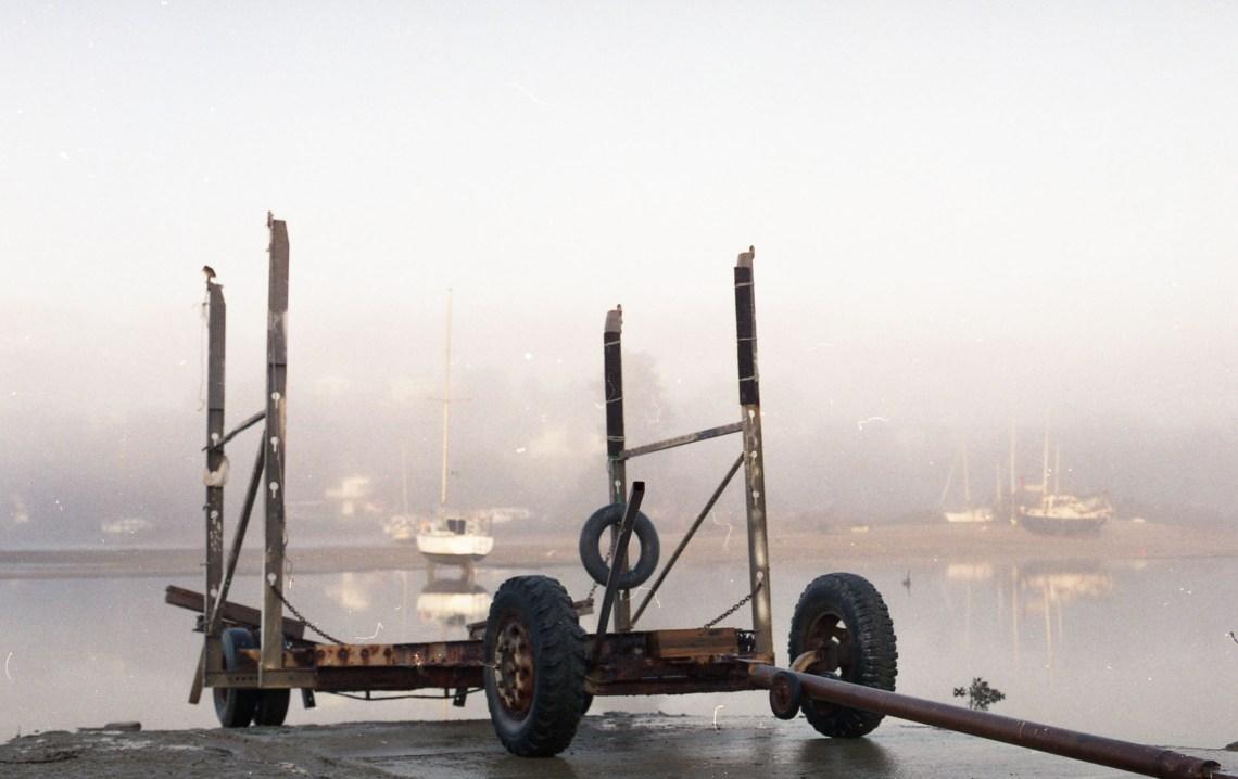 boat trailer in the fog, waiheke island, new zealand. (c) leonie wise
