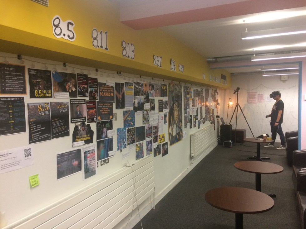 A collage of images and news articles about the Hong Kong protests form a timeline on a wall of the SU.