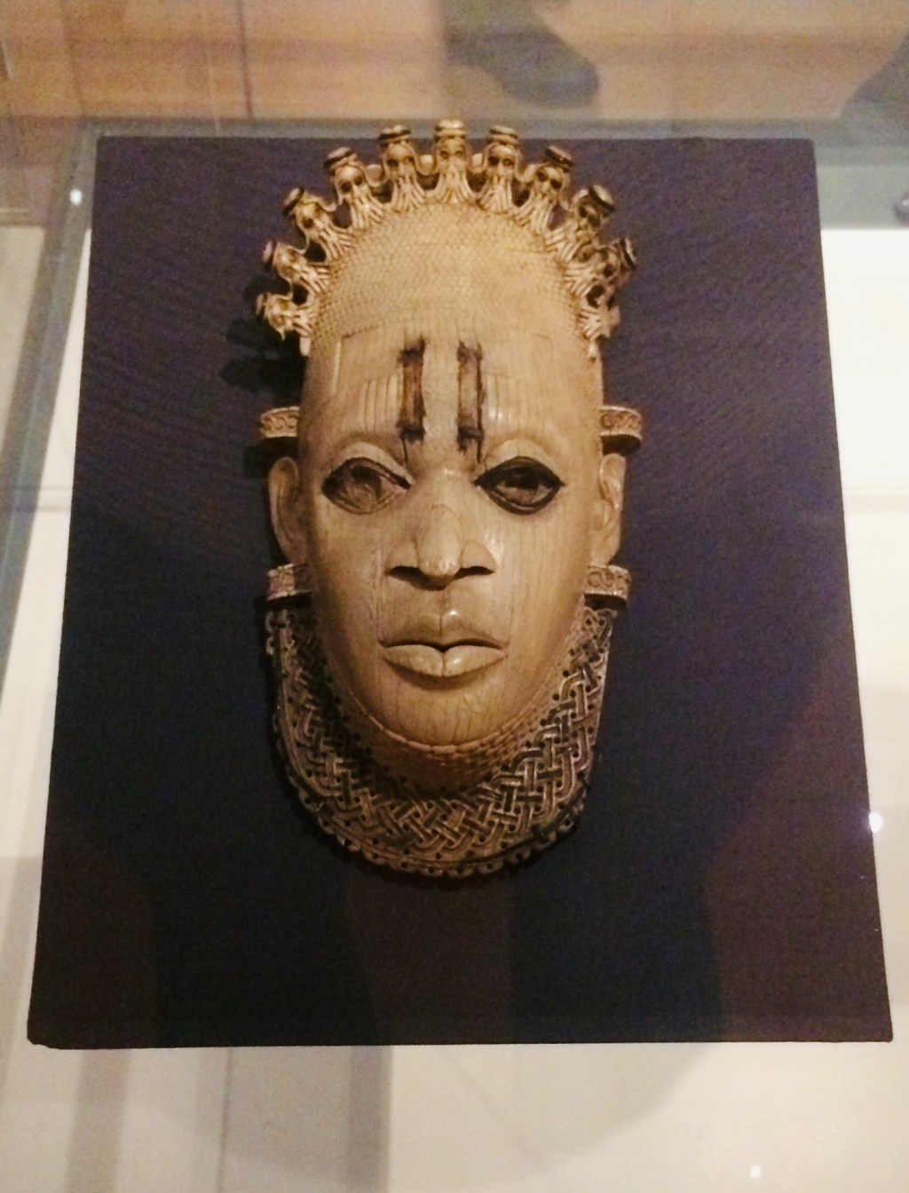 An ivory mask sculpture in the likeness of Queen Mother Idia, a powerful ruler in the 16th century Benin Empire