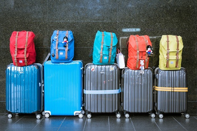 To pack for a family move, assign suitcases with backpacks with necessities for each family member.