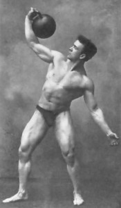 Old Time Strongman performing a kettlebell lift. Photo courtesy of Kettlebell Science