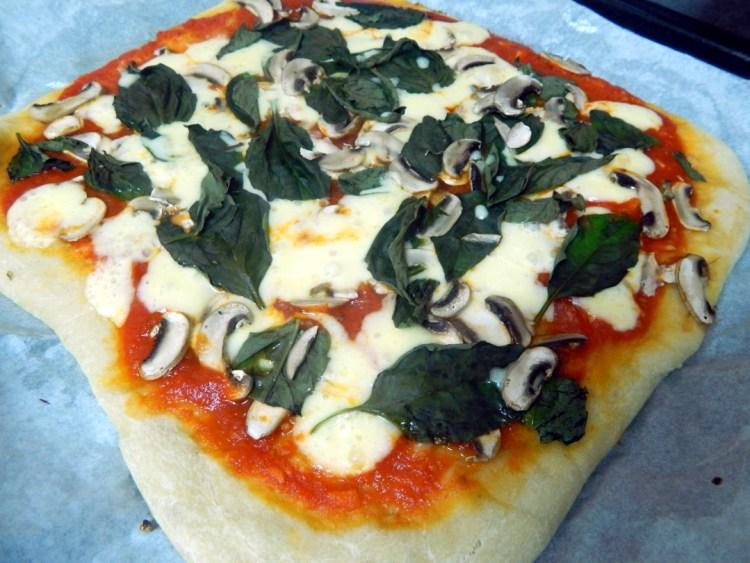 Mushroom,basil and mozzarella pizza