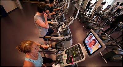 100824, Rhiana Maidenberg listened to an audio book on her mobile phone while watching television during a workout in San Francisco