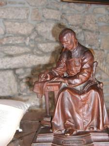 Sao Luis Maria Grignon de Montfort escrevendo o Tratado