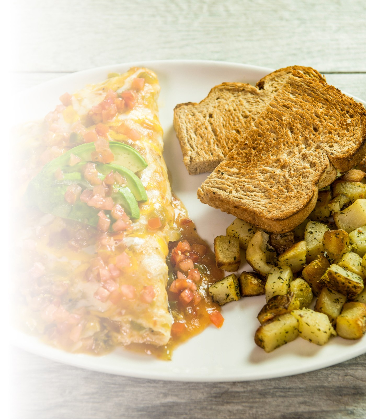 Breakfast eggs, toast and potatoes