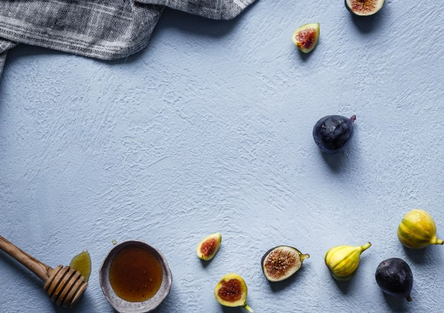 fresh figs whimsically arranged on a kitchen counter
